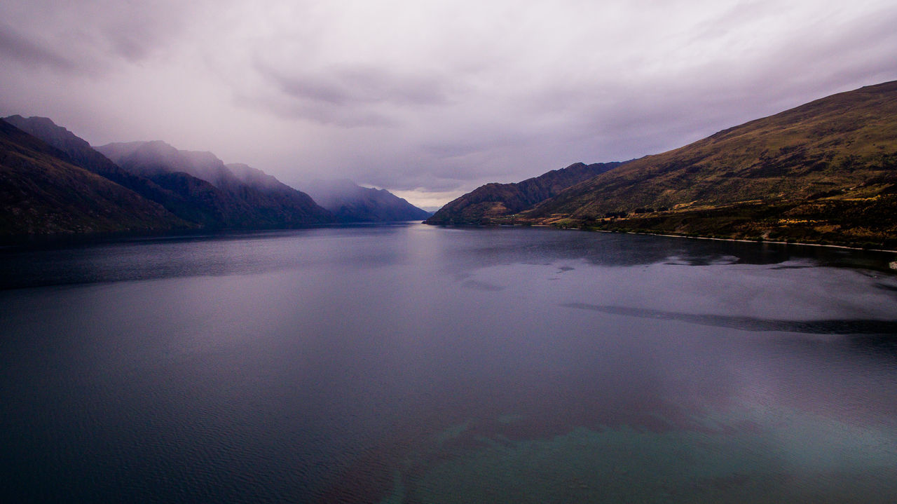 060 Lake Hawea lake wakatipo blue crytsal clear panorama Wanderlust Aboutpassion Aerial Photography Beauty In Nature Cloud - Sky Idyllic Lake Mountain Mountain Range Nature No People Non-urban Scene Reflection Scenics - Nature Sky Tranquil Scene Tranquility Vanlife Water Waterfront