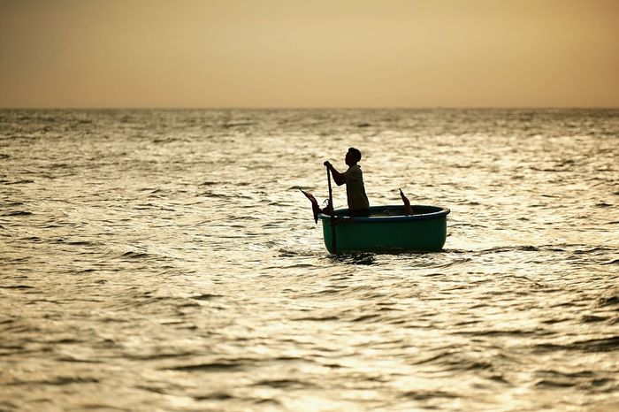 Lonely Vietnamese Fisherman in Sunset, Lifestyle Working Hard Traveling Sea Light And Shadow Water Reflections