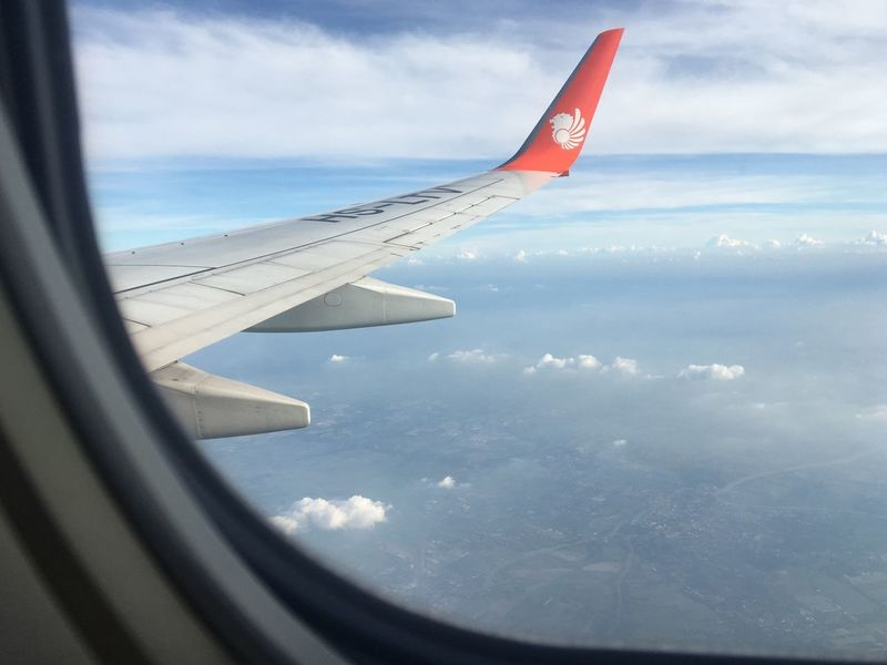 Airplane wing Airplane Air Vehicle Cloud - Sky Sky Flying Mode Of Transportation Aircraft Wing Day Window Travel Transportation