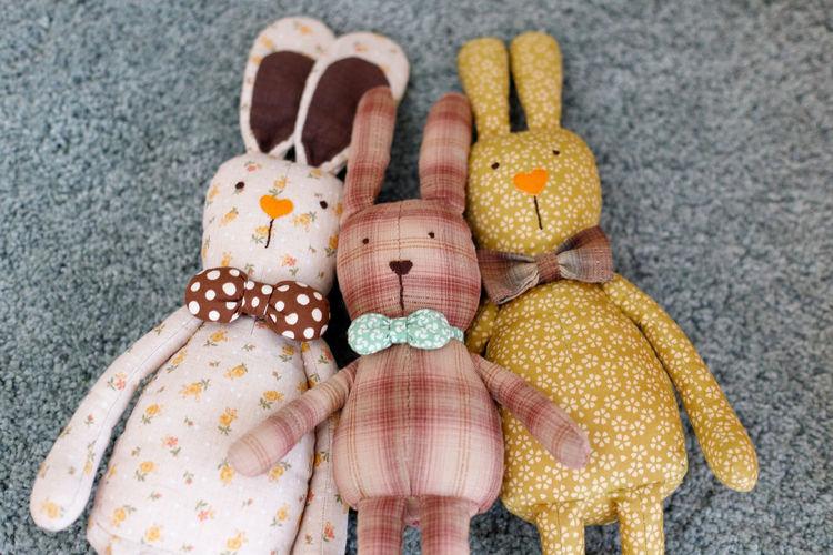 Handmade fabric bunny doll Close-up Variation Holiday Representation Choice Celebration Day Animal Human Hand Indoors  Animal Representation Pattern Handmade Fabric Bunny  Rabbit Dolls Art And Craft Cute