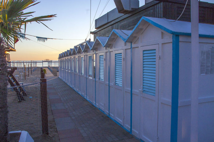 Architecture Beach Beach Cabins Beach Hut Blue Building Exterior Built Structure Day No People Outdoors Sky Sunlight Sunset