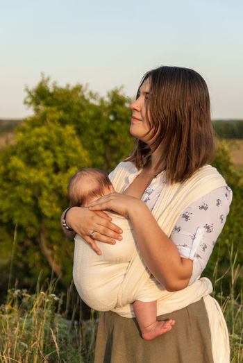 Looking for inspiration in nature Baby Baby Sling Baby Wrap Babywearing Bonding Childhood Children Confidence  Day Family Happiness Lifestyle Love Maternity Mom Mother And Son Motherhood Outdoor Outdoors Parenting Portrait Real People Sling Summer Woman Live For The Story