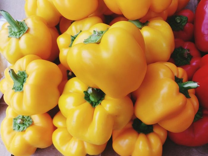 Close-up of yellow and red bell peppers