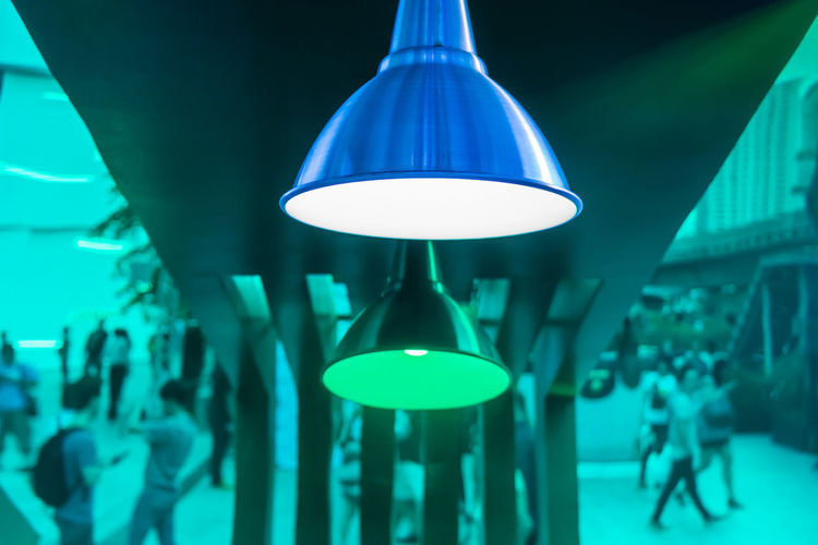 Beverage booth decoration and design with modern lamp. Green plastic sheet to be mirror crowd. Abstract Art Blue Ceiling Contemporary Crowd Decoration Design Electric Lamp Electric Light Electricity  Greeen Hanging Home Interior Idea Illuminated Indoors  Lamp Light Lighting Equipment Mirror Reflection Shadow Sheet Young