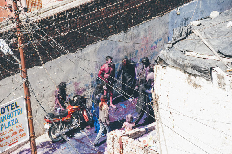 People working at construction site in city
