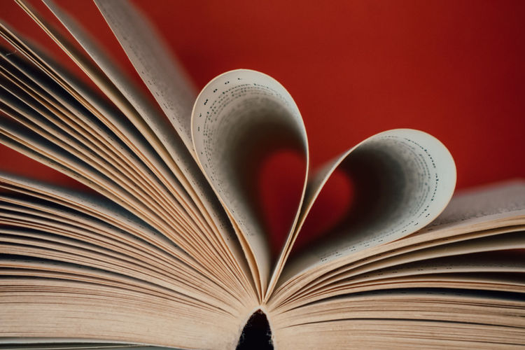 Close-up of heart shape on book