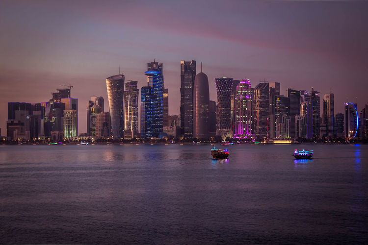 Building Exterior Architecture Built Structure Building City Sky Illuminated Urban Skyline Water Waterfront Landscape Cityscape Tower Transportation Modern Doha Doha,Qatar Middle East
