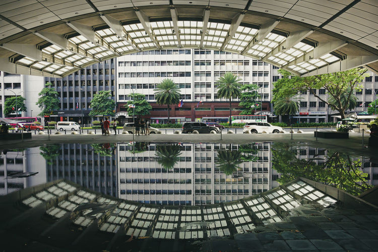 Reflection of building in swimming pool