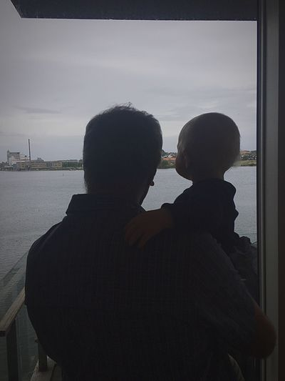 My dad and my sisters son, looking out of the window. The new learning from the old, and my dad wishing him good luck on his adventure in life.👨‍👦👶🏼👴🏼 Oldandnew Newandold Two People Love Water Real People Togetherness Men A New Beginning Sky Silhouette