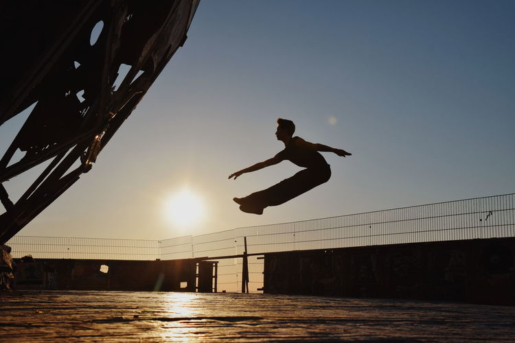 Modern Dance Ballet Dancer Teufelsberg Berlin Model Male Dancer Male Model Jumping Jump EyeEmNewHere Urban Wallpaper Streetphotography Berlin Sportsman Sport Flexibility Water Men Sports Clothing Sunset Exercising Stunt Extreme Sports This Is Strength A New Perspective On Life Capture Tomorrow 2018 In One Photograph Moments Of Happiness My Best Photo 17.62° The Art Of Street Photography