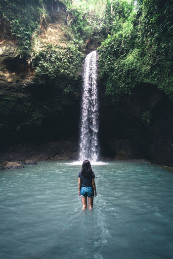 Young woman standing in front of a perfect waterfall on the Indonesian island Bali Bali Exploring Lifestyle Nature Adventure Adventure Girl Beauty In Nature Explore Forest Leisure Activity Nature One Person Outdoor Woman Outdoors Real People Rock Formation Standing Vacations Wasserfall Water Waterfall Waterfront Woman In Nature Young Adult Young Women Go Higher The Great Outdoors - 2018 EyeEm Awards The Traveler - 2018 EyeEm Awards