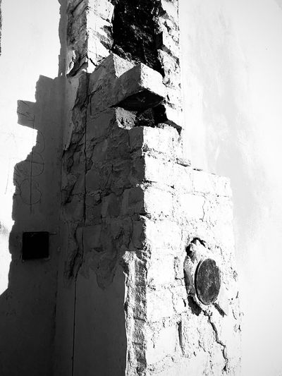 Low angle view of old weathered wall