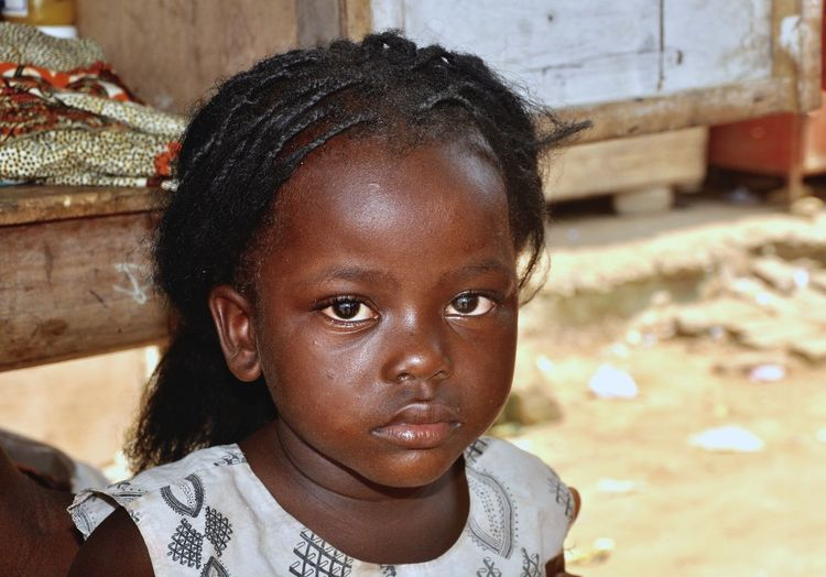 Close-up portrait of girl in village