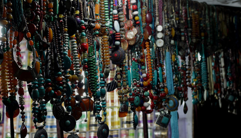 Delhi Haat Market, New delhi, India Bangles Beeds Bells Dilli Haat Hanging Bells Love Birds Market No People