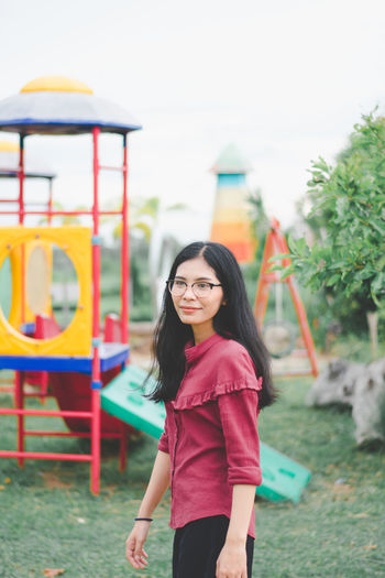Smiling Young Woman Standing At Playground