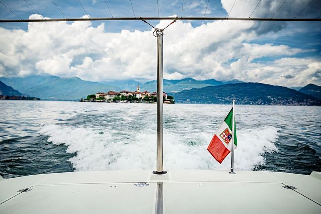 So sad to say CIAO to this amazing place... Check This Out Hollidays Travel Nopeople From My Point Of View Italy Boat Water Lake Posh Luxury Flag Italy Holidays Motorboats Island Selective Focus Nature Clouds And Sky Cloudscape Beautiful Feel The Journey