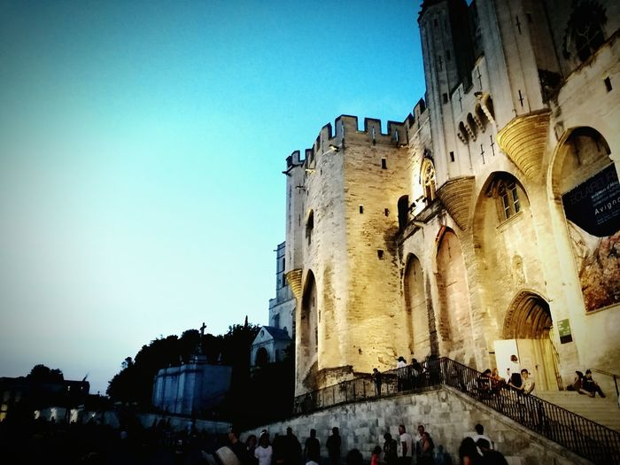 Architecture Large Group Of People Built Structure Travel Destinations History Old Ruin Building Exterior Ancient Vacations Ancient Civilization Clear Sky Men Women Day Outdoors Real People Illuminated People Adult Adults Only Avignon Palais Des Papes AvignonFestival
