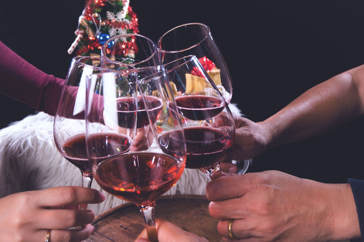 Alcohol Celebration Celebratory Toast Drink Food And Drink Glass Group Of People Hand Holding Human Hand Indoors  Leisure Activity Lifestyles Men Real People Red Wine Refreshment Smiling Wine Wineglass