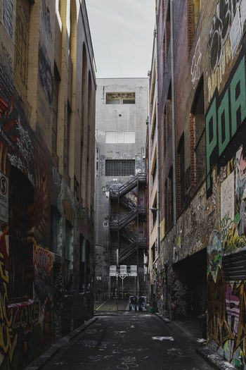 Alley Alleyway Alleyways Architecture Building Building Exterior Built Structure City Communication Day Direction Graffiti Incidental People Narrow Outdoors Residential District Road Sign Street Tag Text The Way Forward Transportation