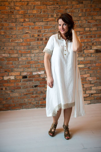 Adult Adults Only Beautiful Woman Brick Wall Day Front View Full Length Indoors  Linen One Person One Woman Only One Young Woman Only Only Women People Real People Smiling Standing Summer Fashion Young Adult Young Women