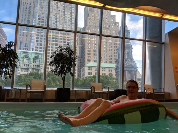 New York Hilton Hotel Millenium Hilton Adult Day Full Length Hot Tub Leisure Activity Lifestyles Luxury Nature One Person Outdoors Pool Portrait Real People Relaxation Sitting Swimming Pool Water Window Young Adult