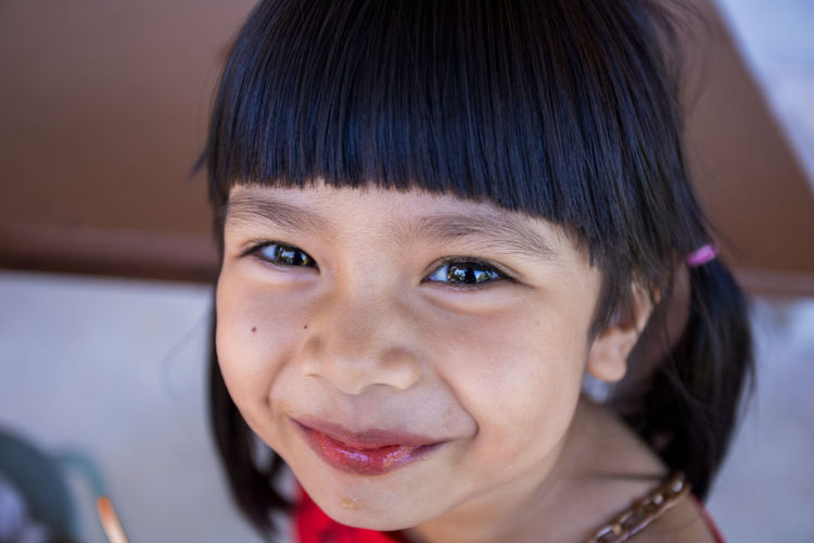 Close-up portrait of smiling cute girl