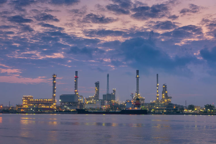 Heavy industrial Architecture Building Exterior Built Structure Cloud - Sky Distillation Environment Factory Fuel And Power Generation Industry Nature No People Oil And Gas Industry Oil Industry Oil Refinery Outdoors Pollution Refinery Sky Smoke Stack Sunset Technology Water Waterfront