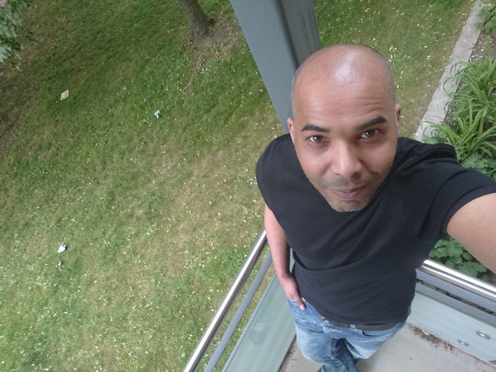 Me Ich Today Home Garden Balcony Portrait Looking At Camera Men Smiling Shaved Head City Water High Angle View Casual Clothing