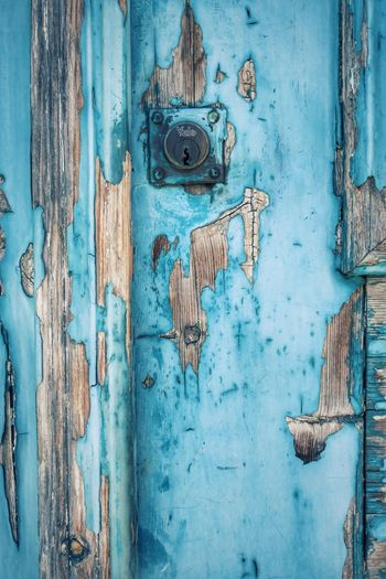 Full frame shot of weathered blue door