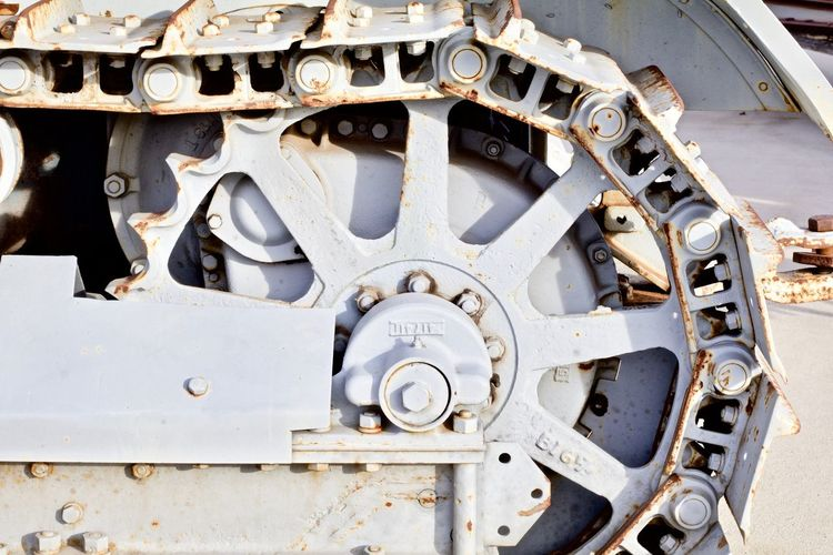Close-up of machine part of ship