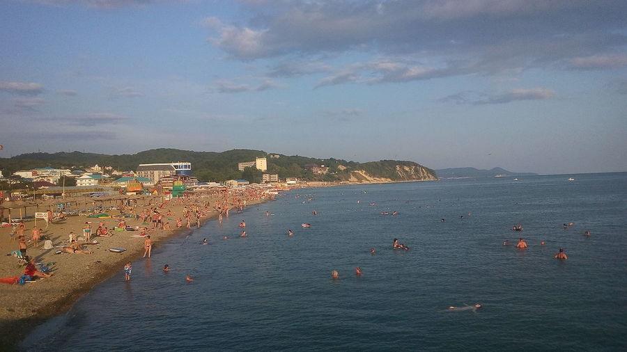 High angle view of tourists on beach