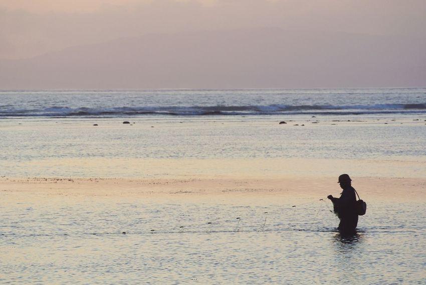 Sunrise. Ocean Travel Seascape EyeEm Nature Lover Romantic Sky Nature Photography Panorama Nature Fisherman Fishing Sanur Bali Bali, Indonesia INDONESIA Island Sunrise Water Sea Beach Full Length Sand Silhouette Wave Low Tide Fishing Net Calm Scenics Coast Horizon Over Water Tranquil Scene