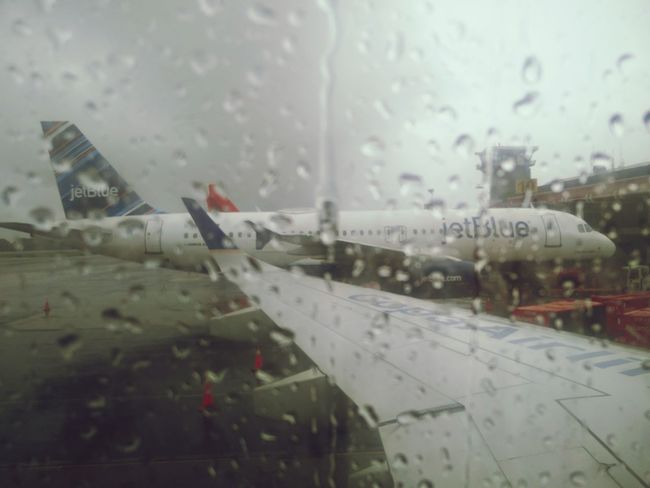 Airplane Air Vehicle Airport Flying Airport Runway Window Commercial Airplane Outdoors Sky Day Rainy Day Jetblue Avianca Copa Airlines