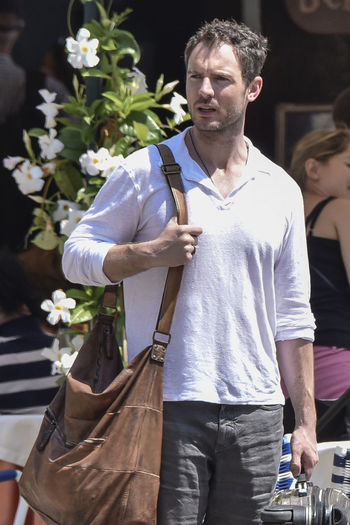 the actor Richard Flood, in Portofino - Summer 2016 Actor Bag Casual Clothing Celebrities Celebrity Sighting Focus On Foreground Front View Gabriella Pession Italy Person Portofino Richard Flood Standing Vip Well-dressed Young Adult