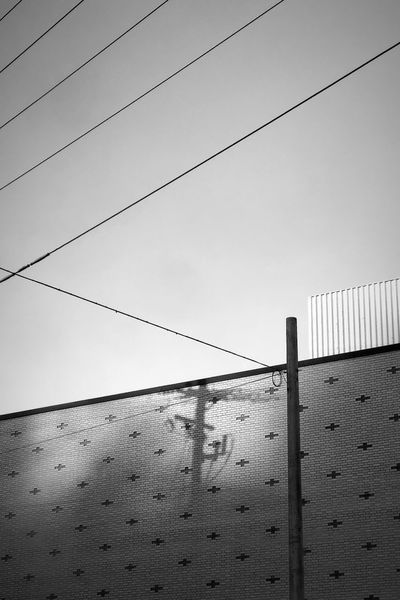 Street Photography Simplicity Minimalist Minimalism Power Lines Shadows Low Angle View Outdoors Connection Cable Day No People Sky Architecture Building Exterior