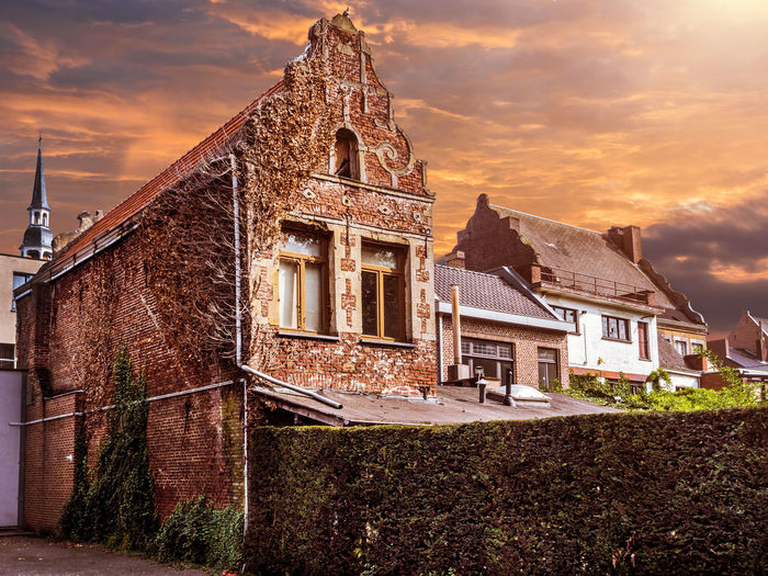 Old buildings of Maaseik town. Belgium Belgium Gothic Gothic Architecture Maaseik Architecture Building Exterior Built Structure Cloud - Sky Europe Evening Sky Gothic Style Limburg Old Architecture Old Buildings Outdoors Sky Street Sunset Town Urban