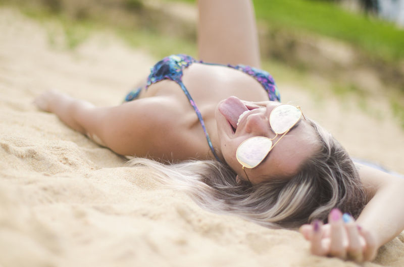 Lying Down One Person Relaxation Sand Land Leisure Activity Lifestyles Beach Day Real People Lying On Back Nature Selective Focus Summer Women Childhood Child Vacations Outdoors Innocence