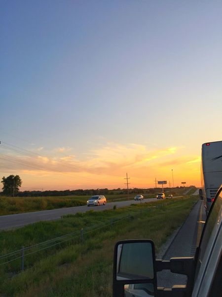 Road trip driving interstate midwest United States america summer fields clouds landscape road traveling vacation sunset sky cars motor home