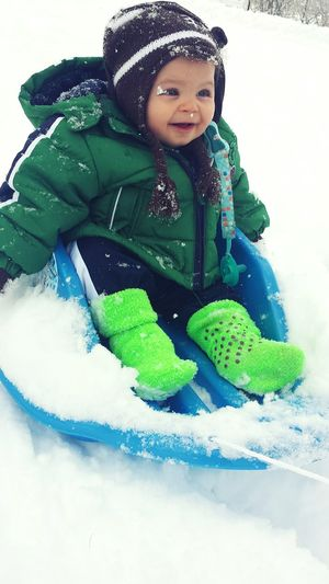 My sweet baby boy sledding for his very first time