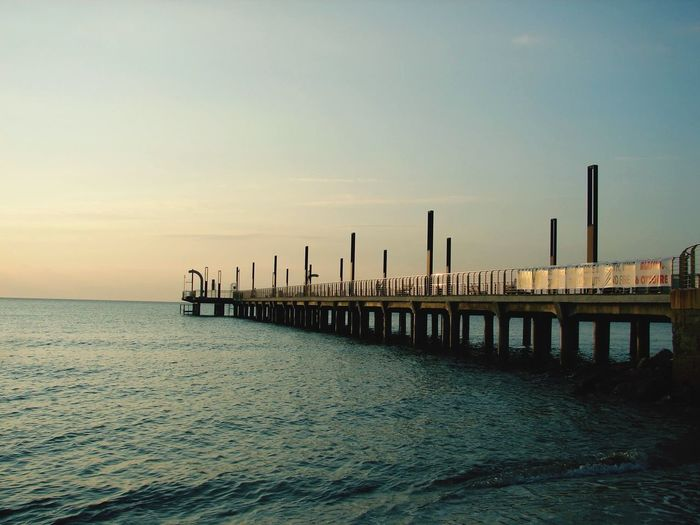 Píer Water Sky Sea Scenics - Nature Waterfront Pier Nature No People Beauty In Nature Tranquil Scene Tranquility Built Structure Outdoors Sunset Horizon Over Water Architecture Horizon Post Rippled Wooden Post