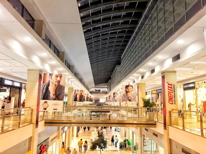Indoors  Ceiling Store Architecture Retail  Modern Large Group Of People Illuminated People Day Indoors