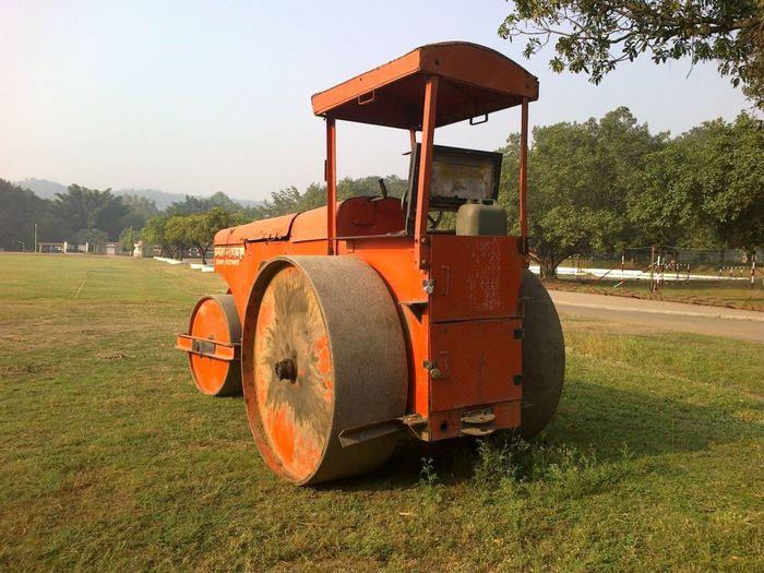 Steamroller on grassy field