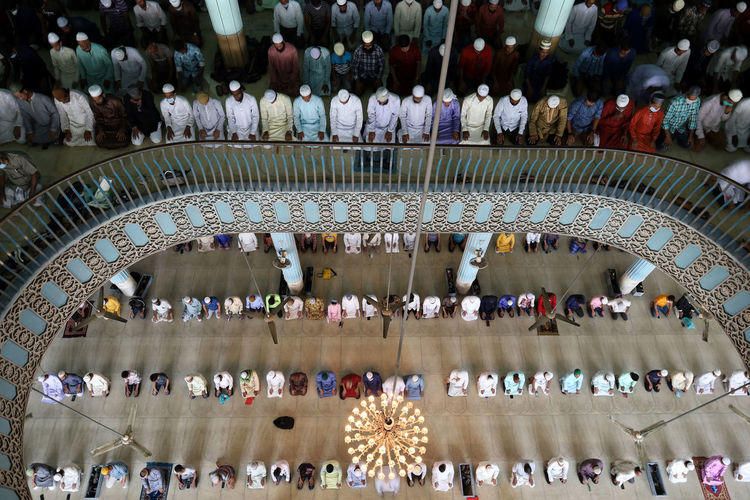 High angle view of group of people in mosque