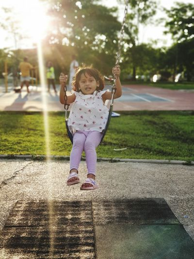 Swing, sunset & sweetheart Samsungphotography Samsung Note 9 Malaysia Malaysia Truly Asia Child Childhood Full Length Girls Happiness Sunlight Playing Shadow Fun Front View Swing Outdoor Play Equipment Playground Chain Swing Ride Toddler  Only Girls EyeEmNewHere Autumn Mood