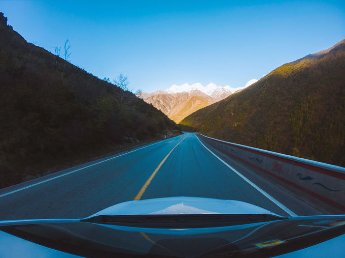 Travel, car, on the road China Landscape Outdoors Travel Traveling Road Car Mountain Transportation Road Marking Windshield The Way Forward Direction Sky Nature Diminishing Perspective Mode Of Transportation No People Vehicle Interior Mountain Range vanishing point Car Point Of View Road Trip Highway