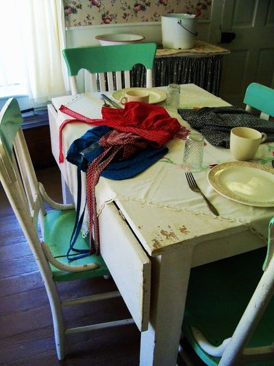Scotland Hotel Museum in Scotland, Indiana 1800s Antique Bonnets Buket Chairs Curtain Dishes Door Furniture Glass Green History Kitchen Living History Mugs Museum Plates Red Scotland, Indiana Silverware  Small Town USA Table White Window Wood Floors The Traveler - 2018 EyeEm Awards