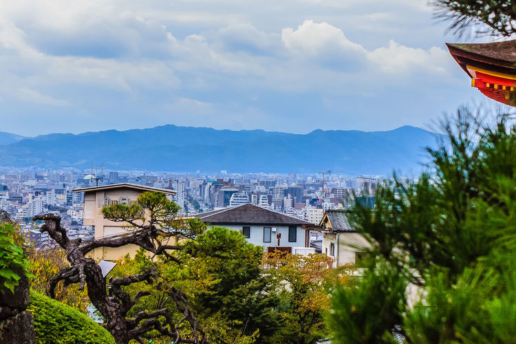 Cityscape View of Kyoto city from Kiyomizu temple with dramatic cloudy sky on background. Cityscape Dramatic Sky Kiyomizu-dera Kiyomizu-dera Temple KiyomizuTemple Kyoto Tower Kyoto Temple Kyoto, Japan Architecture Building Exterior Built Structure Day Dramatic Landscape House Kiyomizu Dera Kyoto Kyoto City Kyoto Garden Mountain Mountain Range Mountains And Sky Nature Pine Trees Sky Tree