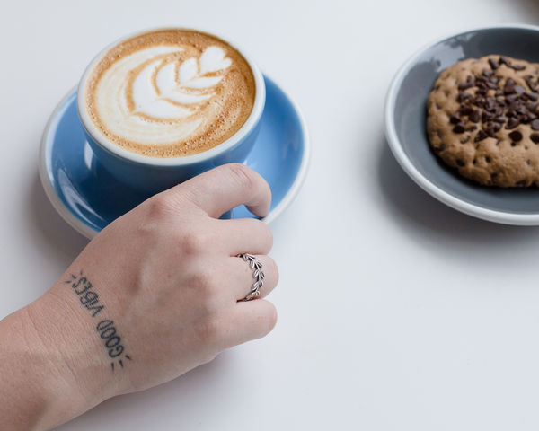 Cappuccino Close-up Coffee - Drink Coffee Cup Cookie Day Drink Food Food And Drink Freshness Froth Art Frothy Drink Holding Human Body Part Human Hand Indoors  Latte Lifestyles One Person Real People Refreshment Saucer Tattoo White Background Wrist
