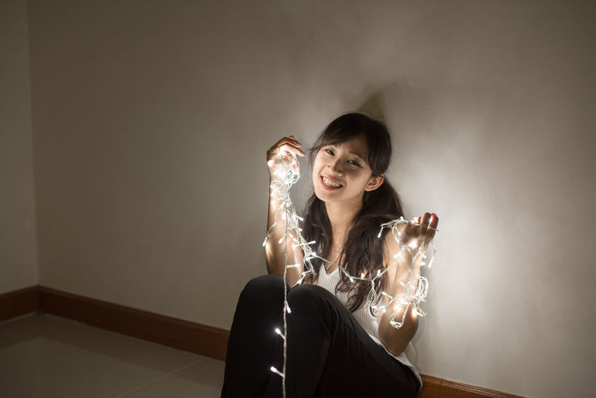 Beautiful Christmas Fun Happy Light Portrait Of A Woman Romantic Room Shadows & Lights Woman Xmas Art Beams Of Light Concept Cute Girl Light Christmas Magic Portrait