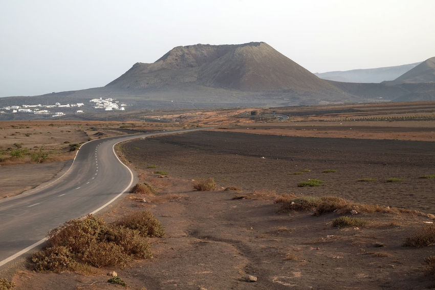 Lanzarote, Spain Canary Islands Landscape_Collection Lanzarote Peace SPAIN Beauty In Nature Day Landscape Landscape_photography Mountain Nature No People Outdoors Road Scenics The Way Forward Tranquil Scene Tranquility Transportation Travel Destinations Volcano